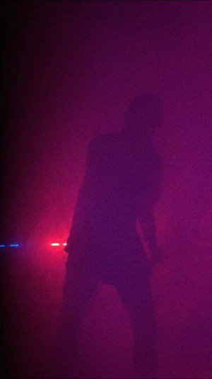 Street Sect's vocalist Leo Ashline immersed in fog.